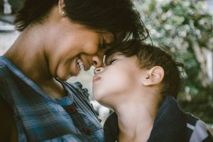 Mom and Son touch heads - The challenges of repatriation for expat kids